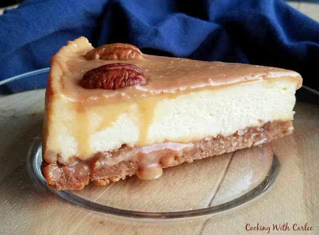 slice of cheesecake with caramel and pecans