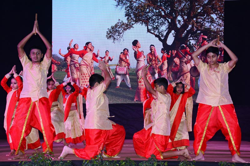 Students perform on stage during annual day celebrations