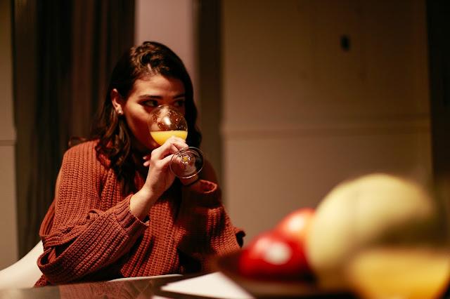 fashion blogger drinking a mimosa