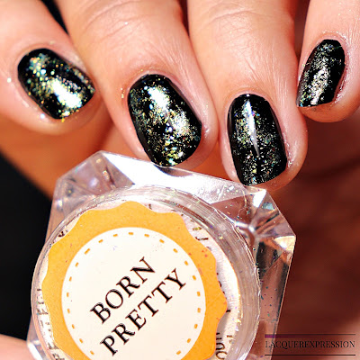 Nail swatch of Born Pretty Store chameleon neon powder mirror flakies over a black creme