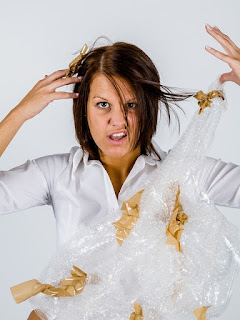image Woman Tangled in Packing tape and bubble Wrap to Illustrate De-stress Christmas!