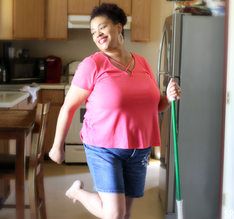 a woman dancing while cleaning
