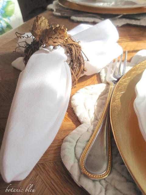 Thanksgiving gold and white table setting with inexpensive grapevine wreath napkin rings