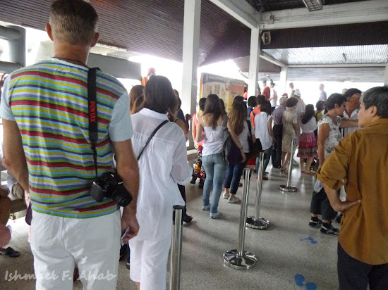 Tourists lining up for boats at Sathorn Pier, Chao Phraya River