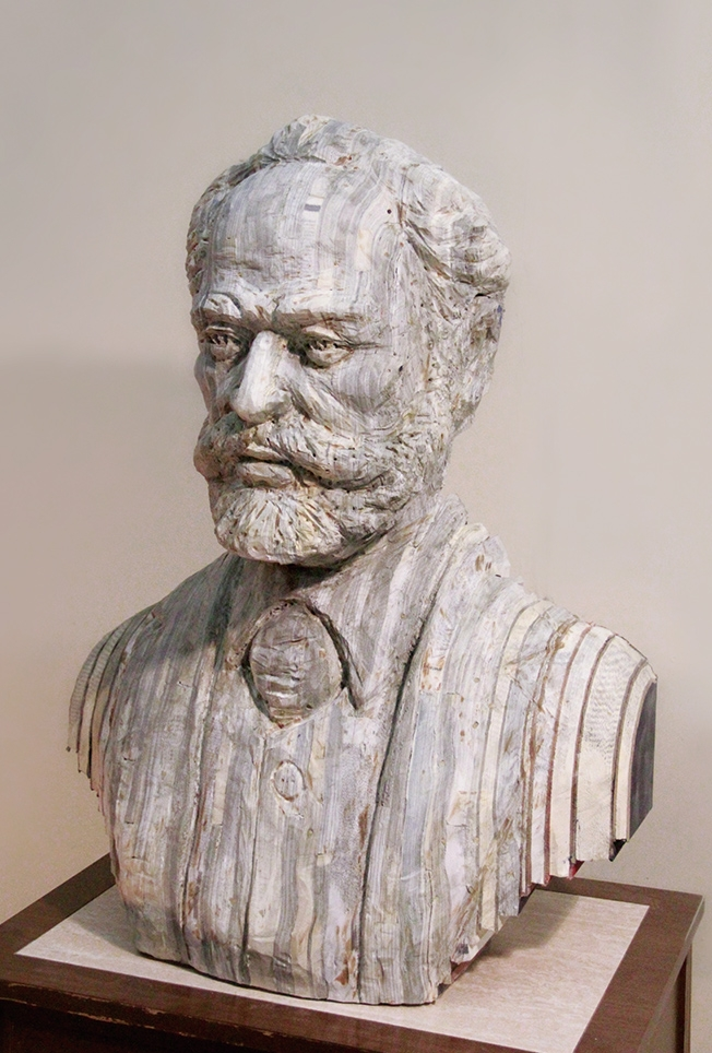 21-Tchaikovsky-Long-Bin-Chen-A-Second-Life-for-Recycled-Book-Sculpting-www-designstack-co