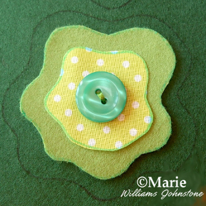 Green fabric felt and button detail