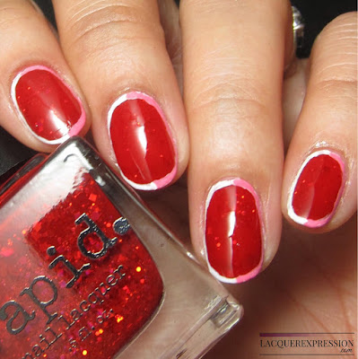 modern valentine manicure using nail polish Festive by Vapid Lacquer and pink and white acrylic paint
