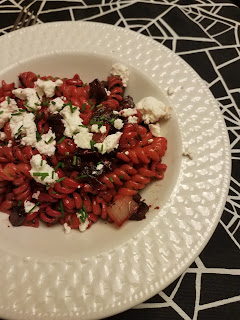 beet pasta with basil pesto and goat cheese