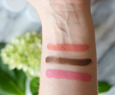Swatches of RMS Beauty Lip2Cheek in Demure, Lip Polish in Honest, and Contour Bronze
