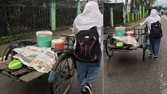 http://www.asalasah.com/2016/02/gadis-sma-ini-bantu-dorong-becak.html