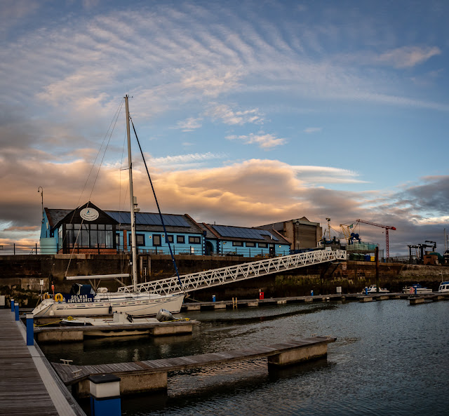 Photo of another view of the clouds over the marina building
