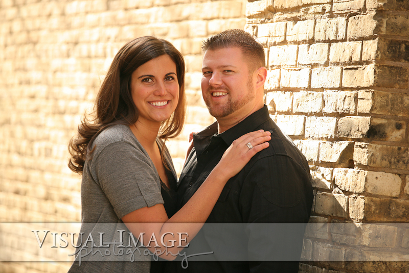 Engaged couple in downtown Cedarburg brick alley