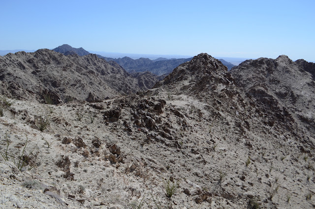 wide ridge with trail along it