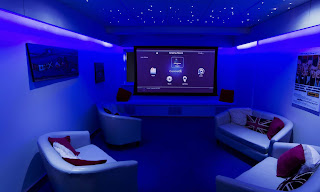 An image of beautiful living room with Tv and purple lights