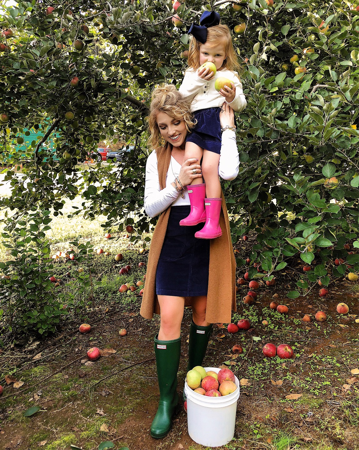Mommy and me apple picking in navy corduroy skirts and hunter boots - Something Delightful Blog