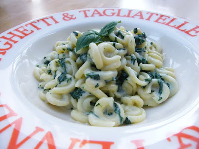 Pasta with Cheese and Spinach Sauce in a bowl