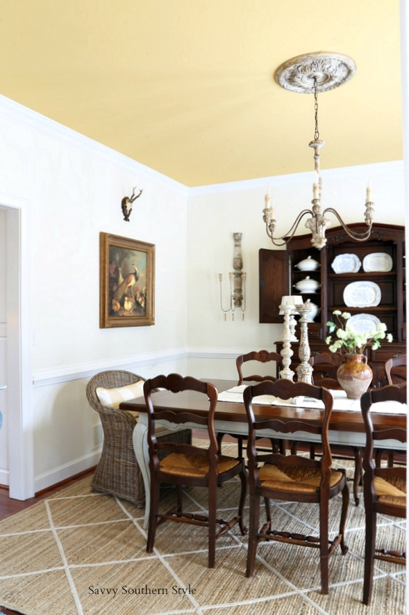 antique French chairs with rush seats move from the breakfast room to the dining room