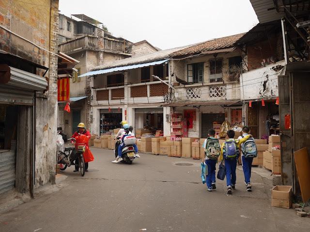 school children walking on Baisha Road in Jiangmen