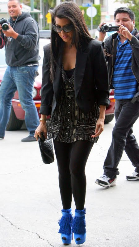 dc4d8f9c3ac Kourtney Kardashian at their NYC Dash store wearing black and brown riding  boots, black skinny jeans, simple black tee, weathered brown jacket with  fur, ...