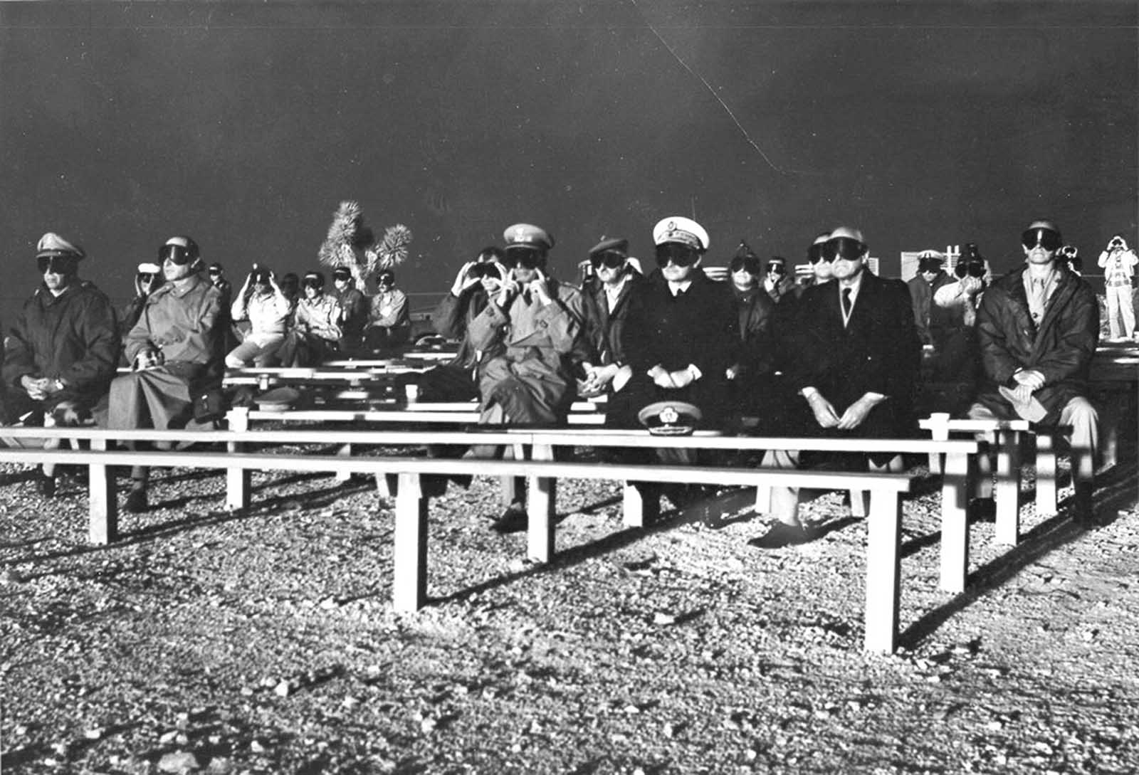 NATO observers watch the detonation of Operation Plumbbob Boltzmann on May 28, 1957.