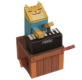 gato de papel tocando piano