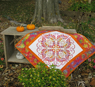 Kaleidoscope Quilted Wall Hanging outside with pumpkins