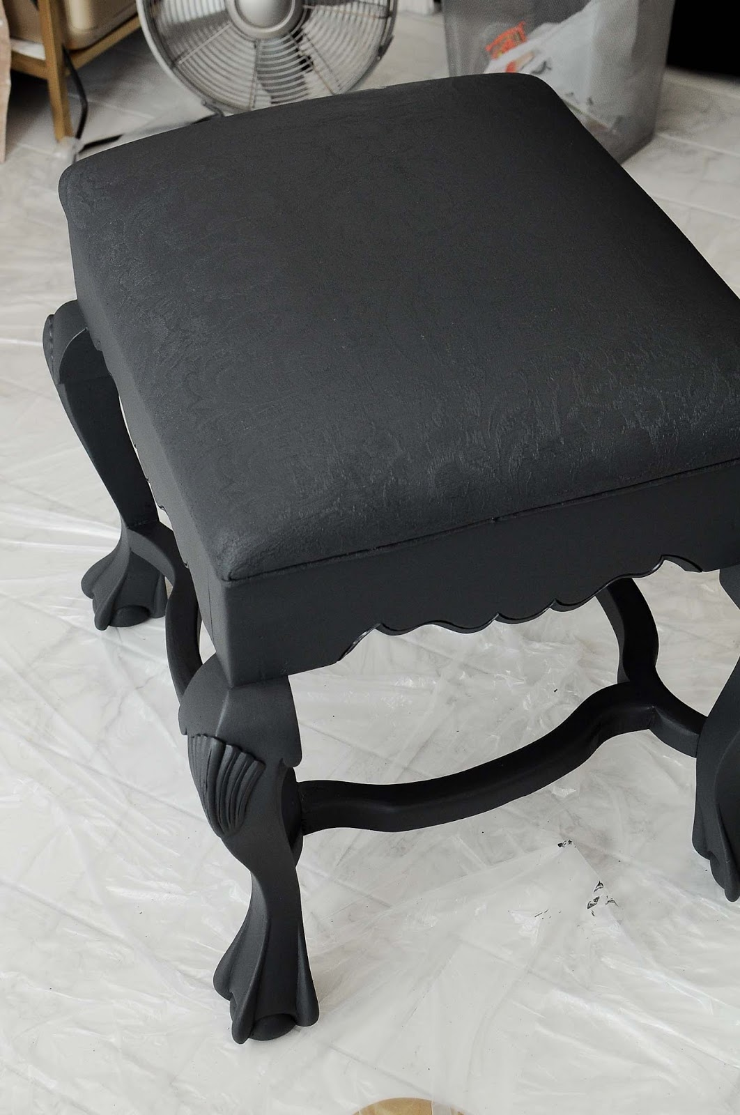 A vintage thrifted ottoman gets a DIY makeover using Velvet Finishes to paint the fabric and wood. What a fabulous idea!