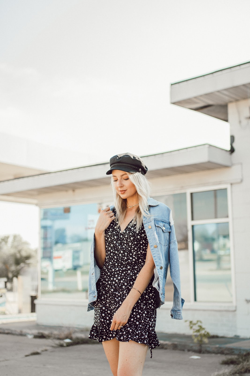 star print dress with a denim jacket and hat