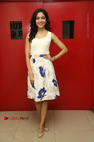 Actress Ritu Varma Stills in White Floral Short Dress at Kesava Movie Success Meet .COM 0030.JPG