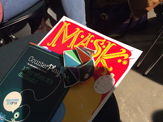 Set of goodies from the CounterPlay conference including mask and chatterbox