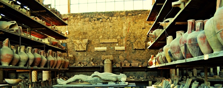 Pottery and Plaster casts of victims in Pompeii
