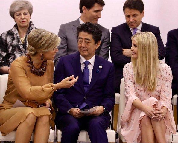 Queen Maxima wore a dress by Natan. Ivanka Trump wore Valentino Snowdrop print silk midi dress. Justin Trudeau