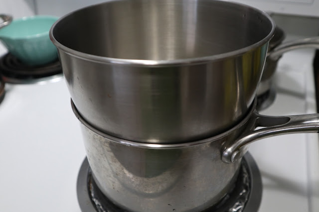 stand mixer bowl over a pot of water