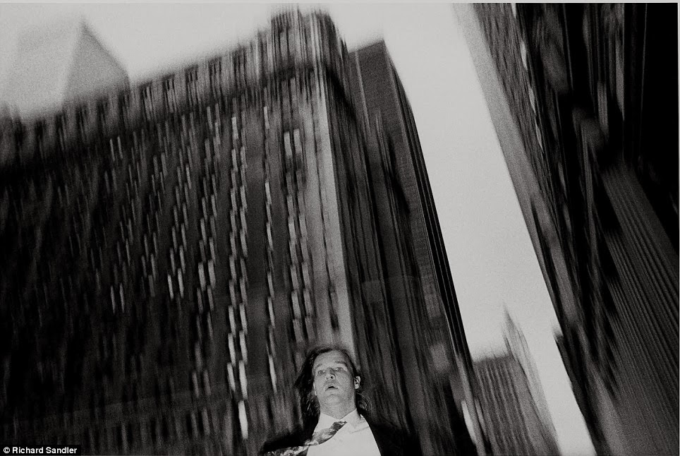 A suited man is captured on camera as he walks near broadway and wall street circa 1987