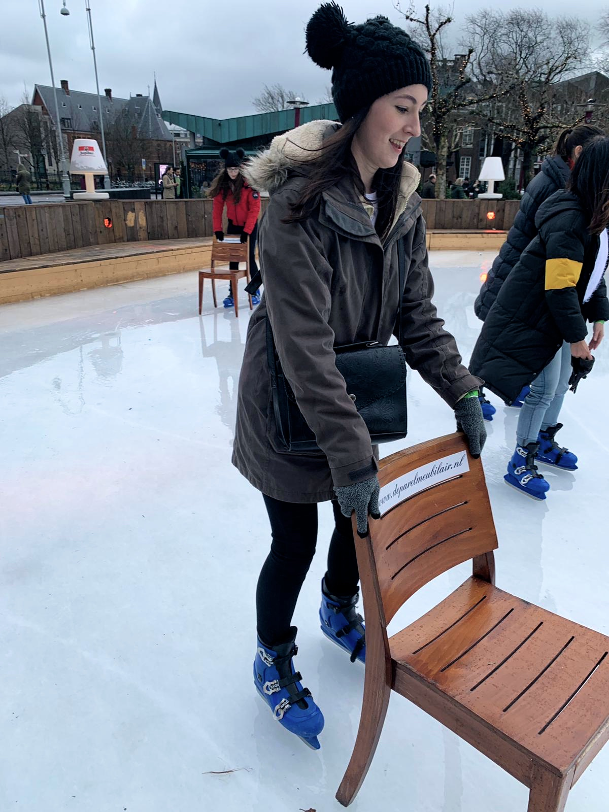 Me skating with a wooden chair