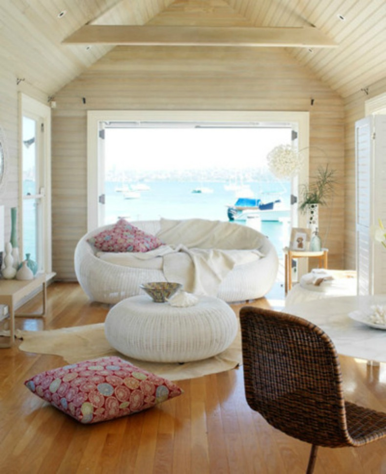 Coastal living room with white slipcover sofa and ocean view