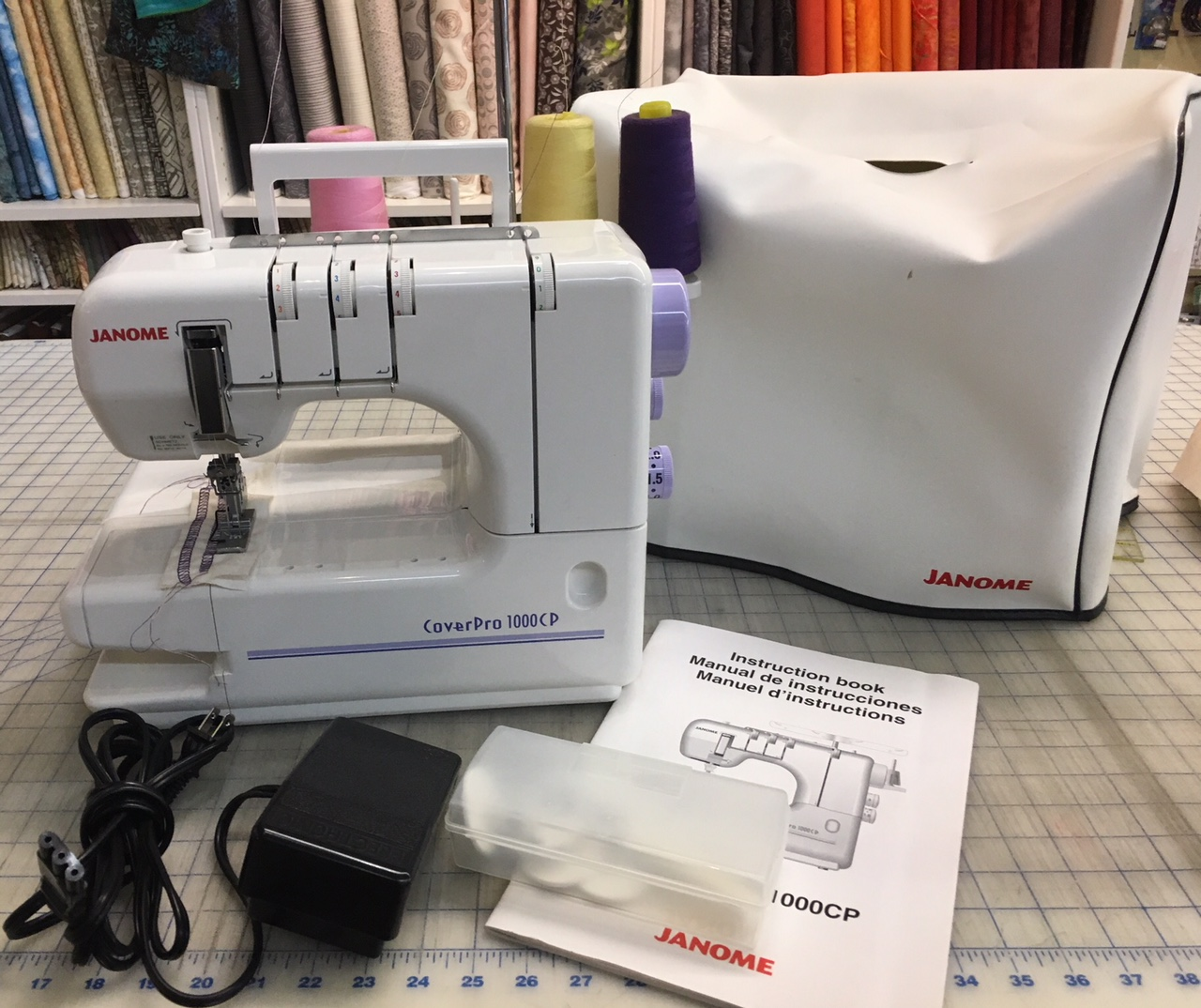 SOLD Janome 1000cp coverstitch machine - comes with dust cover, foot  control, instruction book & accessory box. It is an open arm machine and  can do triple ...