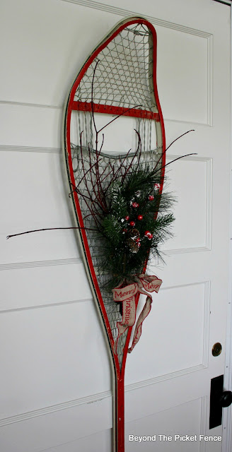 Create and easy decoration with an old snowshoe and pine boughs