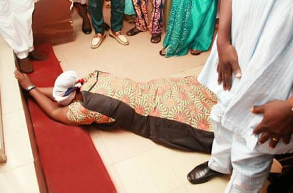 Lepacious Bose rolls on the ground during prayer session