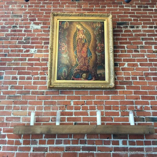 brick walls at La Capilla Mercado de Jugos Y Café in Berkeley, California