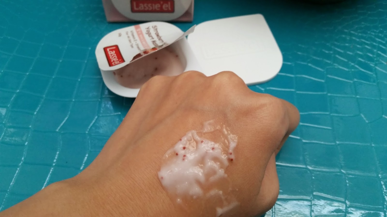 the Strawberry Hydrating Yogurt Massage Mask on the back of my hand
