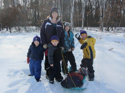 family on a winter nature walk