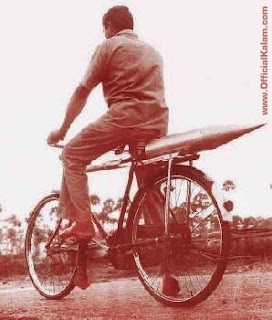 Rocket parts being carried on a cycle during the early days of India's space program.