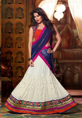 Bollywood Superstar And Indian Model Chitrangada Singh In Cream & Dark Blue Colored Designer Lehenga Choli.