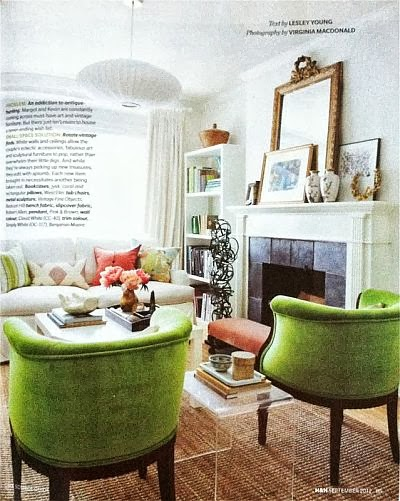 beautiful living room with green armchairs