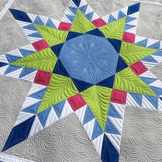 No Y Seam Feathered Star Quilt designed by Jessie of threadedquilting