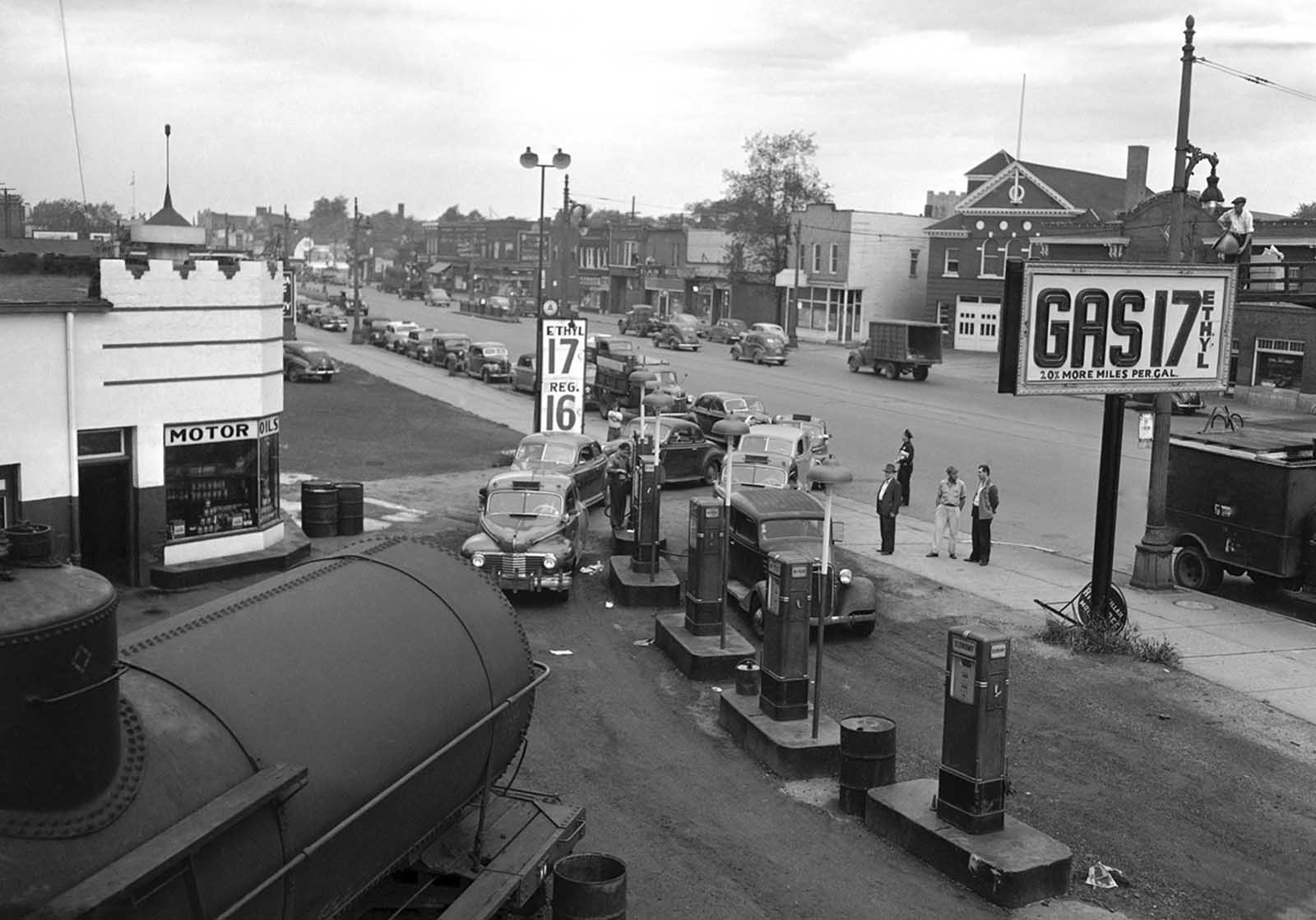 Motorists line a street waiting to buy gasoline at 17 cents per gallon at this station in Detroit on September 24, 1945. Such stations were not affected by a strike of Yank-Wacon truck drivers and did big business as nearly all other stations, supplied by truck, were closed.