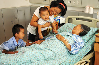Image: The truly inspiring story of the Chinese rubbish collector who saved and raised THIRTY babies abandoned at the roadside