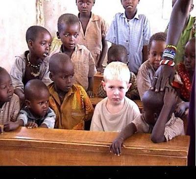 White kid among Black children