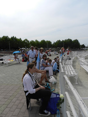Argentinian pilgrims situating themselves well in advance of Mass, at St. James, Medjugorje.
